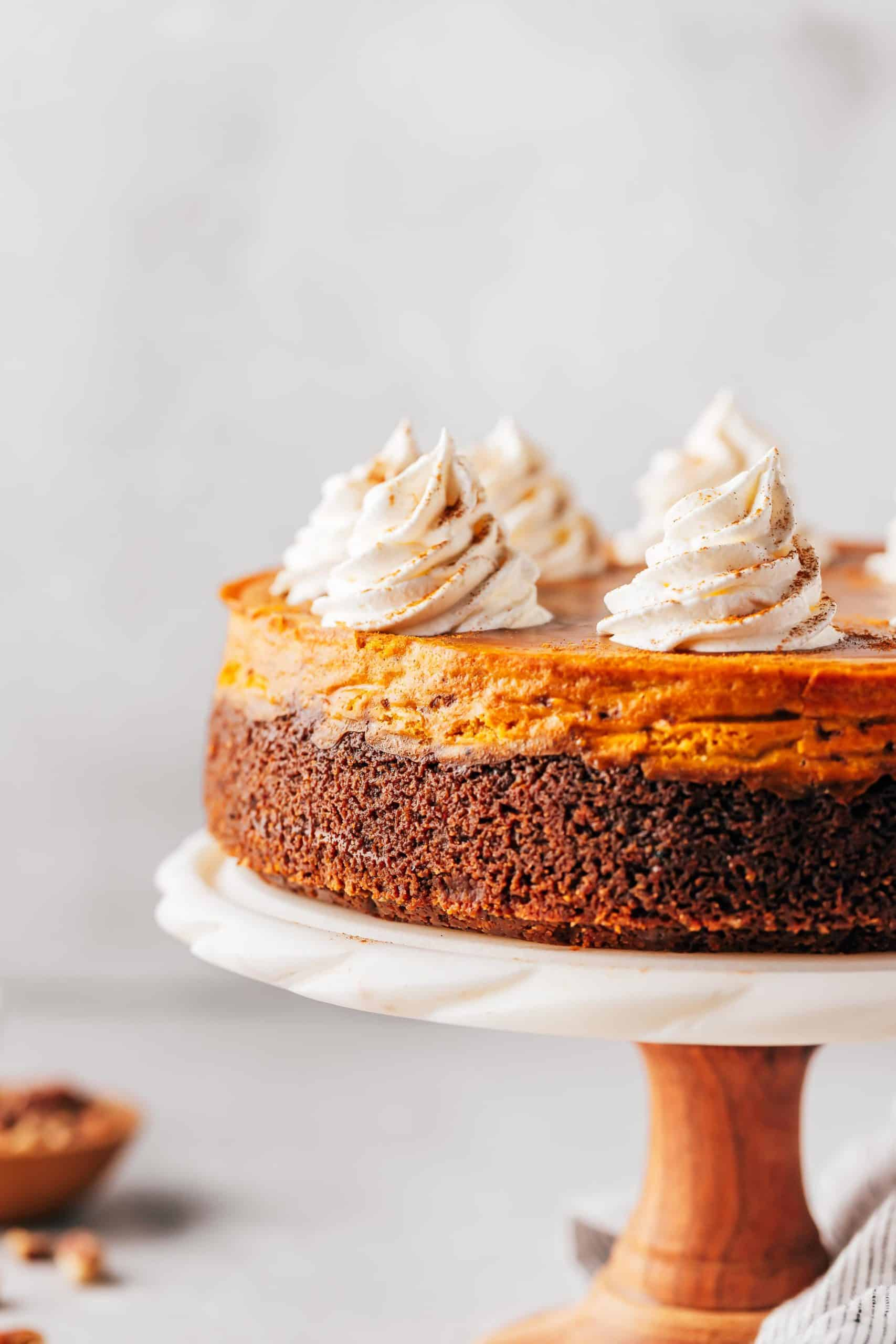 pumpkin cheesecake on a cake stand