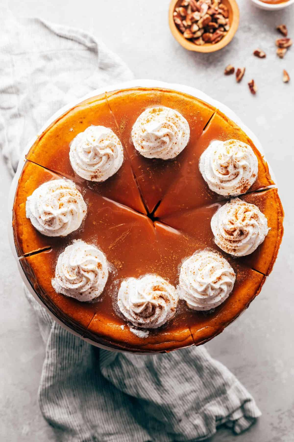 pumpkin cheesecake with caramel sauce and whipped cream