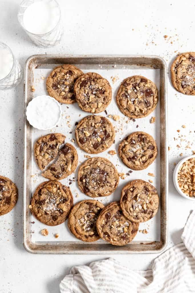 chocolate chip walnut cookies on a baking sheet