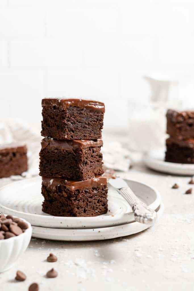 stack of fudgy brownies with ganache