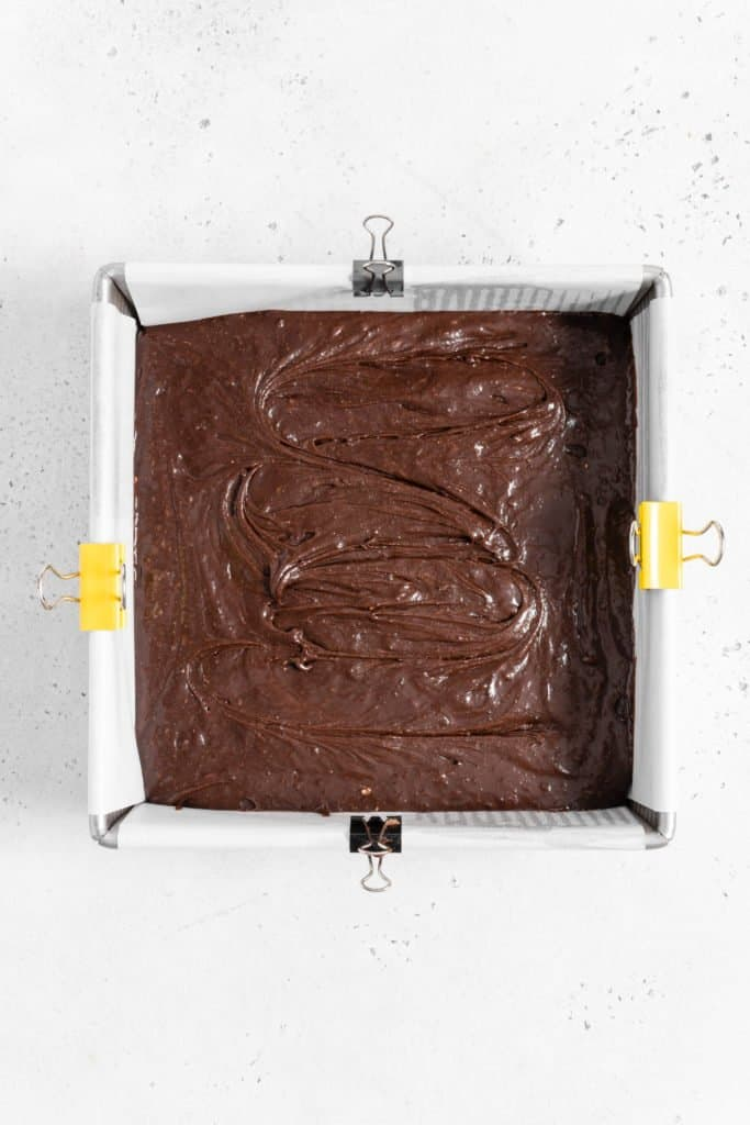 brownie batter in a square pan