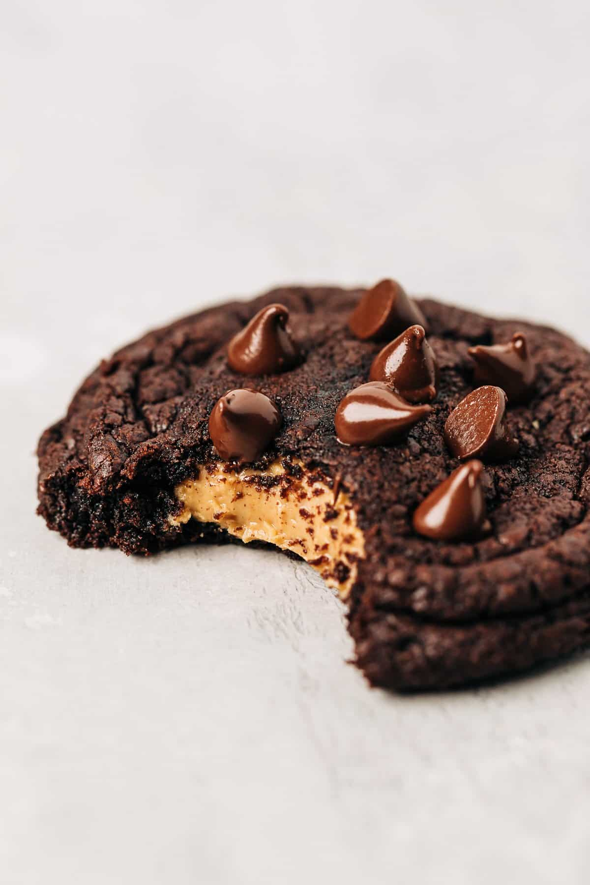 bite shot of a peanut butter stuffed chocolate cookie