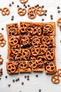 blondies with caramel sauce, pretzels, and chocolate chips