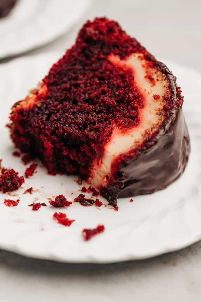 moist Red Velvet Cream Cheese Bundt Cake on a plate