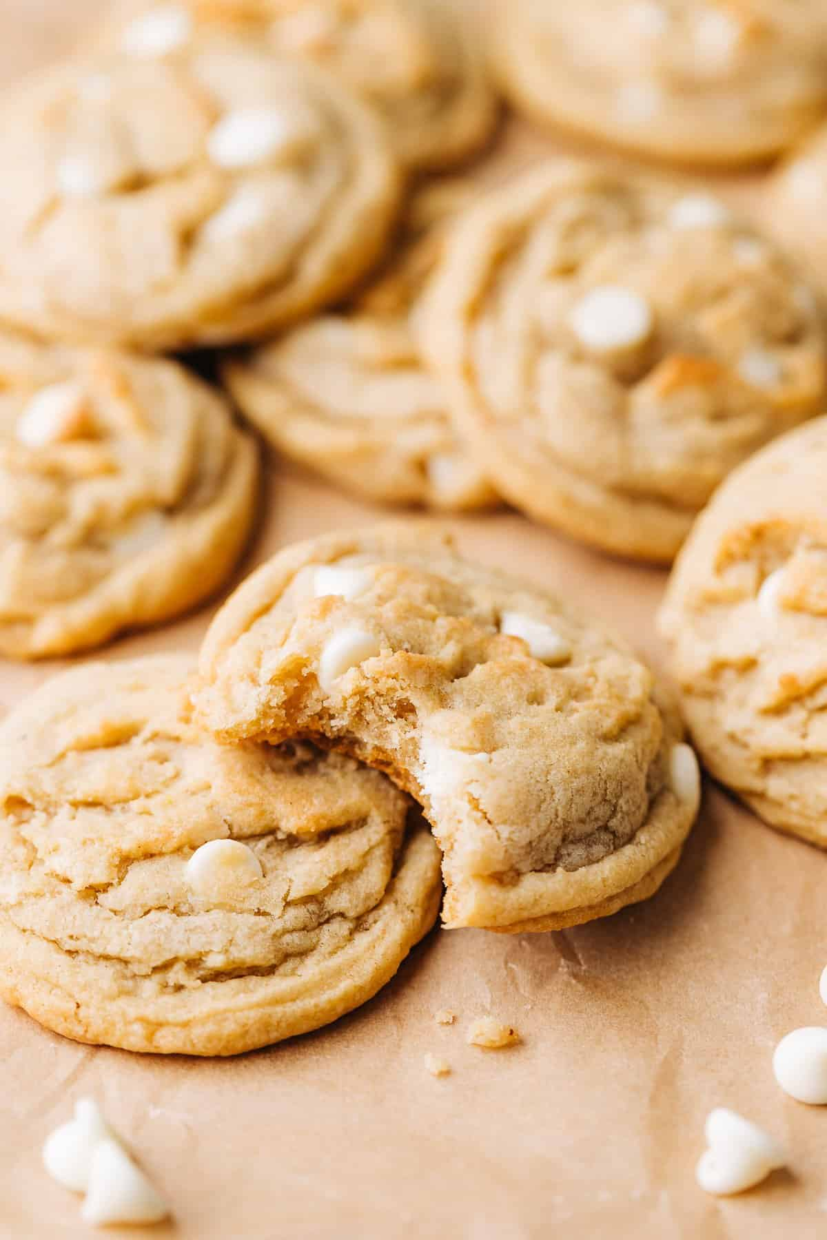 banana white chocolate chip cookies on brown parchment paper.