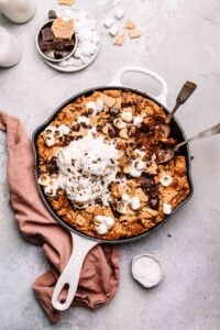S'mores skillet cookie topped with ice cream.