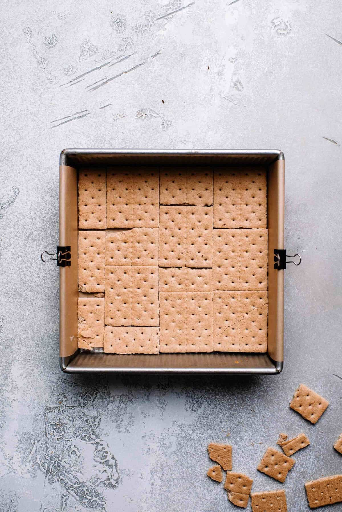 Graham crackers arranged in a baking pan.